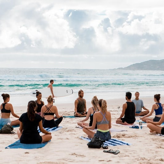 Belongil beach yoga byron bay